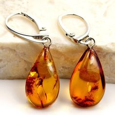'Honey Drops' Sterling Silver Natural Baltic Amber Dangle Earrings  Price : $43.95 http://www.silverplazajewelry.com/Sterling-Silver-Natural-Baltic-Earrings/dp/B00IWTT76O