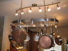 Pot rack hanging above an island in the kitchen..