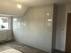 High gloss fitted wardrobes from our Oulton Range
