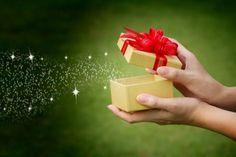 Hand holding Birthday gift with magic star