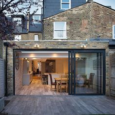 Stunning Earlsfield flat roof extension with stylish flooring running inside to out. ⠀ Stunning Earlsfield flat roof extension with stylish flooring running inside to out. House Extension Design, Roof Extension, Extension Ideas, Design Loft, House Design, Modern Roof Design, Fibreglass Roof, Modern Roofing, Porch Roof