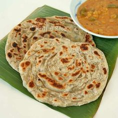 Crispy and fluffy homemade Roti Canai with step-by-step instructions. Delicious eaten with dhal and chicken curry.   Food to gladden the heart at RotiNRice.com
