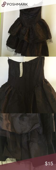 """Black party dress. Cute tiered black party dress with ruffles on top...strapless...approx 25"""" from top of bust to bottom...padded bust...crinoline under top tier & bottom...zippered back...Shell: 55% polyester/45% nylon....Lining: 100% polyester...Contrast: 100% nylon...Never Worn Amp Dresses Strapless"""