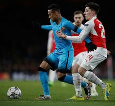 Barcelona's Brazilian forward Neymar (L) vies with Arsenal's Spanish defender Hector Bellerin during the UEFA Champions League round of 16 1st leg football match between Arsenal and Barcelona at the Emirates Stadium in London on February 23, 2016.