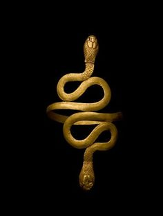 Gold Bracelet from the time of Cleopatra in the shape of two serpents spiraling as a symbol of protection and regeneration. Photograph by Kenneth Garrett.