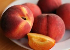 PEACHES: A large peach has less than 70 calories and contains 3 grams of fiber. They are a good source of vitamins A and C.