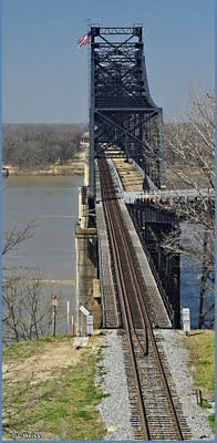 On April 28, 1930, the first bridge to cross the Mississippi between Memphis, Tennessee and the Gulf of Mexico, opened at Vicksburg, linking Vicksburg to Delta.  The bridge was constructed to carry not only rail traffic, by now, the - Illinois Central - but also US Highway 80. The two-mile long span has an 18-foot wide concrete motor vehicle lane, side by side with the single line railroad. Vertical clearance for river traffic is more than 100 feet.