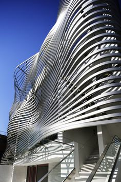 An Undulating Facade of Metallic Louvers Defines This Tokyo Residence and Store. By Amano Yoshihiro, head architect of Amano Design Office Architecture Paramétrique, Beautiful Architecture, Contemporary Architecture, Chinese Architecture, Architecture Portfolio, Futuristic Architecture, Unique Buildings, Amazing Buildings, Office Buildings