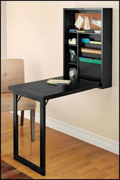 Maximize your home office or crafts space with this DIY murphy craft table!