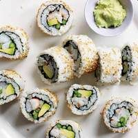 Party Sushi Rolls | http://www.rachaelraymag.com/Recipes/rachael-ray-magazine-recipe-search/appetizer-starter-recipes/party-sushi-rolls
