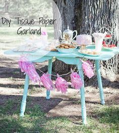 tissue paper garland... spruce up your next party!!! THE RUSTIC REDHEAD