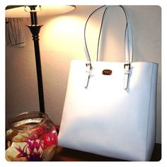 Michael Kors pocket tote Perfect for spring or summer  this large tote is brand new.  It's made of strong but elegant white saffiano leather with gold hardware.  This deep tote can definitely hold all your essentials and more!  I couldn't find its exact measurements online but I'd say it's a large purse. Michael Kors Bags Totes