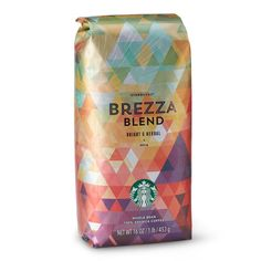 This new light-bodied coffee is as easygoing as its Italian translation would suggest. A medium-roast coffee with notes of fresh herbs and sweet lemon. Brezza is a juicy, elegant, cheerful b Starbucks Coffee Beans, Starbucks Green, Coffee Packaging, Triangle Pattern, Frappuccino, Whipped Cream, Espresso Machine, Packaging Design, Beanie