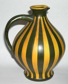 http://www.ebay.co.uk/itm/Wilhelm-Kagel-Pottery-Striped-Bulbous-Jug-Clearly-Marked-Rare-Piece-/152266663077?hash=item2373cce4a5:g:dRwAAOSwT6pVzxvG