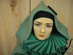 An unusual Lenci doll with a Valentino face.