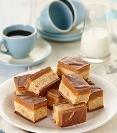 Heather's Fat Bottomed Girl Slice - A great combination of delicious ingredients layered in an easy to cut slice. One taste and you will be in heaven! Chocolate Slice, Cadbury Chocolate, Melting Chocolate, Baking Recipes, Cake Recipes, Baking Ideas, Delicious Desserts, Yummy Food, Sweet Bar