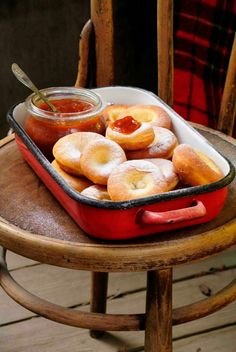 Ribboned Carnival Donuts, traditional Hungarian festive treat, serve with homemade apricot jam and powdered sugar - Farsangi fánk - Ungarische Krapfen