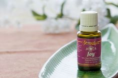Joy is an uplifting blend of pure essential oils that creates magnetic energy and brings happiness to the heart. Mary Jo Cramer-Young Living Distributor ID# 1148381 Joy Essential Oil, Therapeutic Grade Essential Oils, Essential Oil Blends, Young Living Oils, Young Living Essential Oils, Young Living Distributor, Natural Healing, Health And Beauty, Essentials