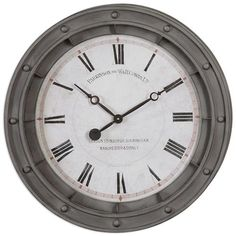 Industrial and antique, this clock adds dimension and visual interest to available wall space. Narrow Roman numerals are outlined with a light red ring. The solid rust grey frame is inspired by marine portholes on shipping vessels - a timeless style that suits coastal, rustic and industrial decor.