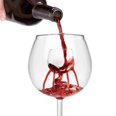 Trevi Aerating Wine Glass All / Food-drink / Wine Rather than pouring wine into space-wasting decanters or fussing with on-bottle wine aerators, just pour your wine into the inner cup of this cool new Trevi Aerating Wine Glass and watch as it passes out through nine aeration spouts, effectively infusing it with flavor and aroma releasing oxygen. Its fountain-like aeration platform not only makes this glass uniquely interesting, it simply makes each sip of wine more of a pleasure to the senses. Makes a great gift and solution for wine connoisseurs or anyone who wants to truly enjoy their favorite red wines.