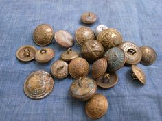 lot of brass ring-back buttons
