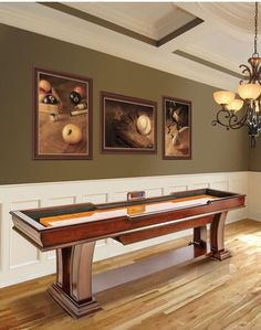 Enjoy an entertaining and challenging game on this superbly crafted shuffleboard table. The elegant arched legs are a beautiful complement to the wood cabinet. The table also features removable bumpers to provide an added dimension to standard game play.