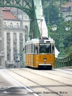 are 9 bridges crossing the Danube and connecting Buda and Pest. Here, a trolley crosses Liberty Bridge, or Szabadság híd. Prague, Liberty Bridge, Capital Of Hungary, Hungary Travel, By Train, Central Europe, What A Wonderful World, Eastern Europe, Wonders Of The World
