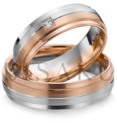 A50 Jedním slovem elegance. Tyto prsteny vás nenechají klidnými. Jsou tak krásné, až se tají dech. Přesně rozdělená kombinace bílého a červeného zlata v kombinaci s lesklými prvky, působí velmi vyrovnaně. Prsteny jsou velmi slušivé a pohodlné. V dámském prstenu je vsazen jeden hranatý briliant. #bisaku #wedding #rings #engagement #brilliant #svatba #snubni #prsteny