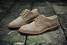 anchordivision: Design Loake Jack Sand Suede Family owned and operated for over 130 years, Loake Shoemakers recently introduced a line combining contemporary designs with the traditional, handcrafted look the English footwear house is renowned for. This line, aptly named Design Loake, releases the Jack Sand Suede brogue, handcrafted in the brand's originally located English factory. Complete with a Goodyear welted wood sole and contrasting stitching, this modern style offers versatility as a…