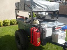 Gas cans to wide. Sleeping platform is good with storage under. Electrical and propane good