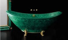 Malachite bathtub shaped like a boat was designed by Luca Bojola and equipped with legs made of gold.