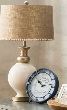Pairing natural burlap texture with a glamorous gold finish, this white glass table lamp offers a pop of shimmer for your living room or reading nook. Find this and more at jossandmain.com