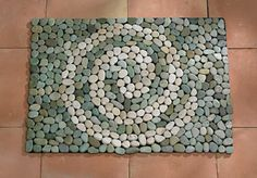 Love this stone mat from Gaelsong Catalog…add to my long list of projects to make!