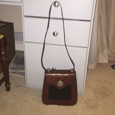 Authentic Brighton Crossbody Handbag black brown This Brighton handbag is in excellent-almost perfect- condition! Black leather and brown leather. Measurements: height: 9 inches, width is almost 9 at widest part, width almost 3 inches. Happy shopping! Brighton Bags Crossbody Bags