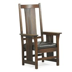 GUSTAV STICKLEY Spindle armchair - Price Estimate: $1500 - $2500
