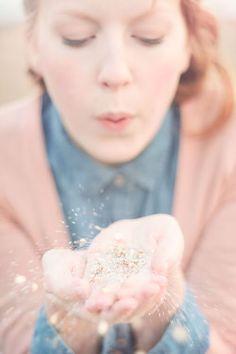 blowing sparkle kisses