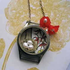 Recycled watch case necklace- interesting