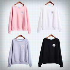 Long-sleeved pullover with white/yellow embroidered daisy on the chest: available in black, pink, white and grey.  Measurements: Length - 60cm  Shoulders + sleeves - 70cm Chest - 104cm