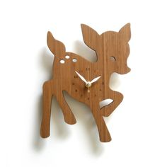 """$74 cute. This adorable fawn clock will help you tell time in case you get lost dancing through the forest.• Size: 7.5"""" x 10""""• Eco-friendly 3ply bamboo**• White hour and minute hands• Gold second hand• Silent Clock Motor• Hanger on the back (wall hanging with pushpin)• Requires one AA battery• Ships well protected** Because of the nature of bamboo, grains and color will be different from the pictures shown."""