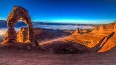 Shadow of the Arch  by William Dodd  Morning sunrise at Delicate Arch in Arches National Park near Moab, Utah.  CameraCanon EOS 5D Mark II LensCanon EF 16-35mm f/2.8L II,ht Focal Length19mm Shutter Speed1/50 secs Aperturef/8 ISO/Film50