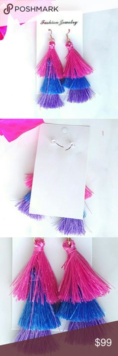 """Erica Nikol Multi-Colored Tassel Drop Earrings 100% new boutique item  Multi-Colored Tassel Drop Earrings  Size: 3.5"""" drop, 1 1/4"""" width Material: Zinc alloy, cotton Color: Multi-Colored (Pink, blue, purple)  Colors may slightly vary from photos. No trades! Bundle 2 or more items for 15% off Erica Nikol Jewelry Earrings"""