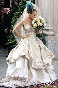 Carrie Bradshaw's aborted wedding in Sex and the City. Focus on the amazing Vivien Westwood couture gown.  Google Image Result for http://stylefrizz.com/img/sjp-satc-westwood-bride-gown.jpg