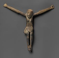 Kongo artists carefully studied European devotional artifacts and stylized certain features in their own interpretations. In this figure, cast to be attached to a wooden cross, the length of the arms has been given dramatic emphasis and attention has been devoted to the head and wrapper