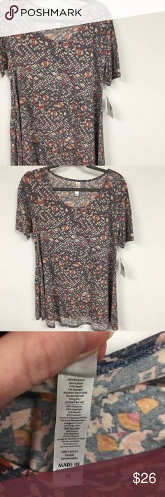 NWT LuLaRoe Med Perfect T Cotton Blend Cotton blend perfect t that is brand new with tags. The Perfect T is tunic length and runs large. Size down 1. LuLaRoe Tops Blouses