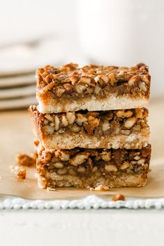Combine everything delicious about pecan pie and pile it on a shortbread crust. The star of your holiday dessert table -- Pecan Pie Bars. The post Pecan Pie Bars appeared first on This Unmillennial Life. Pecan Recipes, Baking Recipes, Cookie Recipes, Dessert Recipes, Holiday Desserts, Just Desserts, Delicious Desserts, Pecan Pie Bars, Dessert Tray