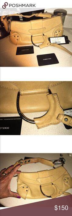 Dolce & Gabbana Tan leathe handbag Dolce & Gabanna Handbag Small Beige leather,Good used condition.Opt for this touch of glamour to finish off evening looks throughout party season.  Structured  leather shoulder bag in Tan. Foldover flap with magnetic press- stud fastening. Logo plaque inside. Zipper closure  pocket at interior. Textile lining  featuring leopard print. Silver -tone hardware. Tonal stitching.. Leather.  Made in Italy. Dolce & Gabbana Bags Mini Bags