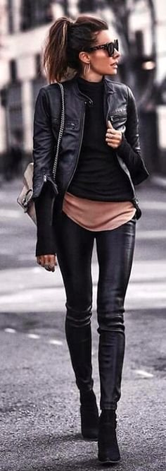 #spring #outfits  woman wearing black leather jacket, black top, and skinny jeans outfit. Pic by @vogue__daily