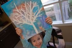 Kid art that looks fantastic!  Use masking tape to mask off the tree - then paint, dry, and remove tape!  So easy and fun.  Gotta try this with Viv....