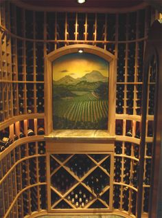 Custom Wine Cellar with Mural and lighting system installed. Click here to learn more - http://www.winecellarsbycoastal.com/custom-wine-cellars.aspx. Coastal Custom Wine Cellars 26222 Paseo Toscana San Juan Capistrano, CA 92675‎ California Office: +1 (949) 355-4376