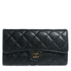 This is an authentic CHANEL Caviar Quilted Large Flap Wallet in Black.   This stylish clutch wallet is crafted of luxurious diamond quilted caviar leather with a small Chanel CC Mademoiselle faux turn lock.